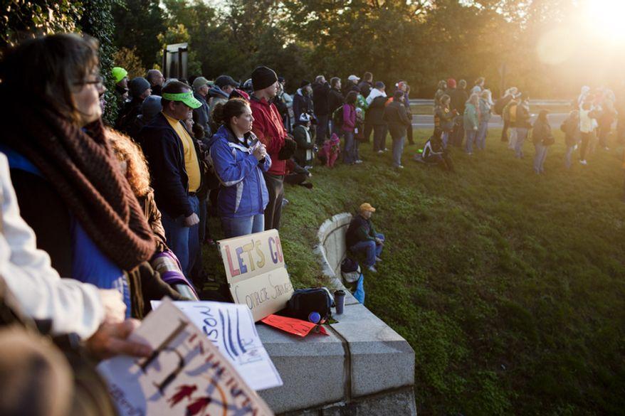 Spectators line a hill to watch the start of the 36th Marine Corps Marathon in Arlington, Va. on Oct. 30, 2011.(T.J. Kirkpatrick/ The Washington Times)