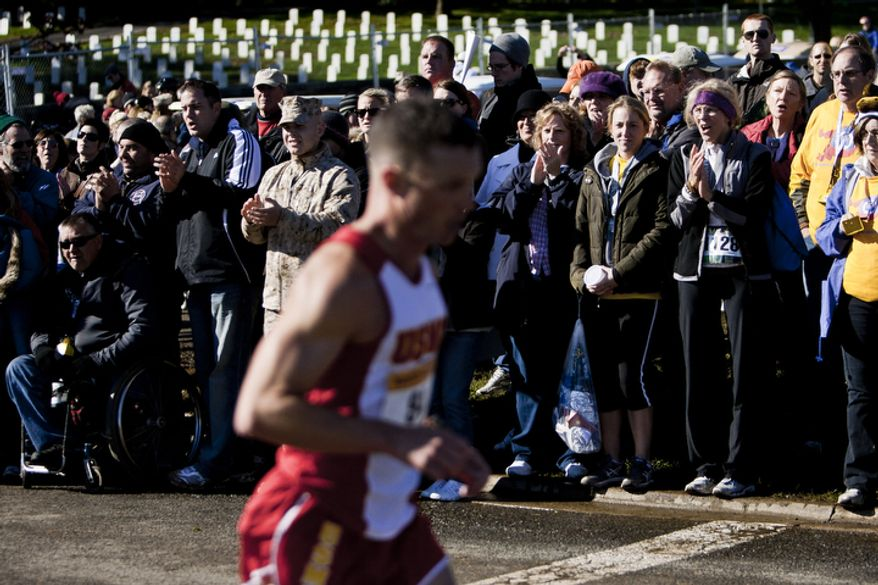 Spectators cheer for runners as they close in on the finish chute during the 36th Marine Corps Marathon in Arlington, Va. on Oct. 30, 2011.(T.J. Kirkpatrick/ The Washington Times)