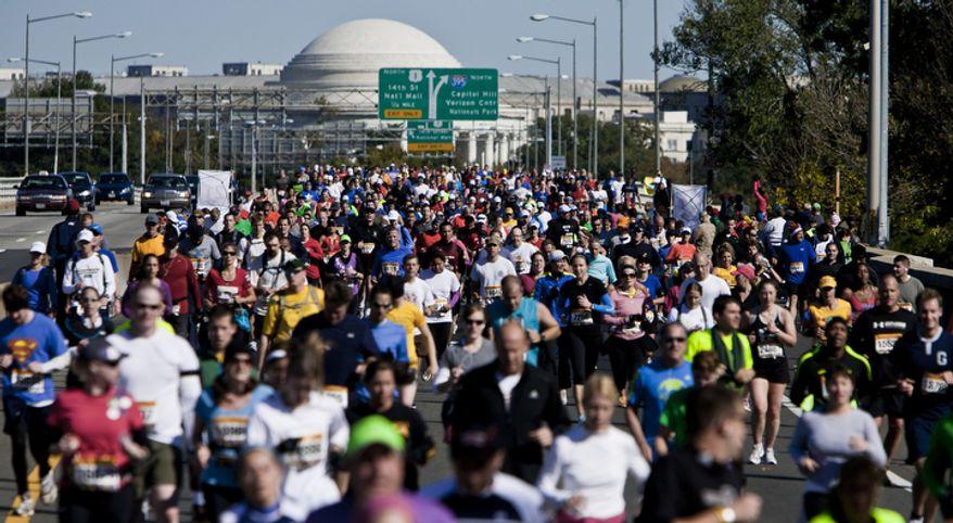 A mass of runners crosses the 14th Street Bridge during the 36th Marine Corps Marathon in Arlington, Va. on Oct. 30, 2011.(T.J. Kirkpatrick/ The Washington Times)