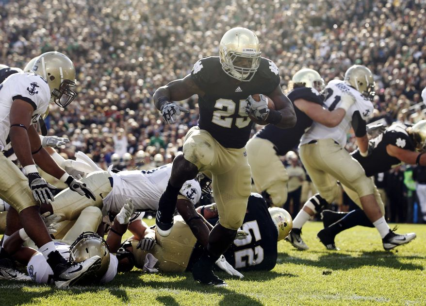 Notre Dame running back Jonas Gray ran for three touchdowns and 69 yards against Navy on Saturday. The Irish won 56-14. (AP Photo/Michael Conroy)