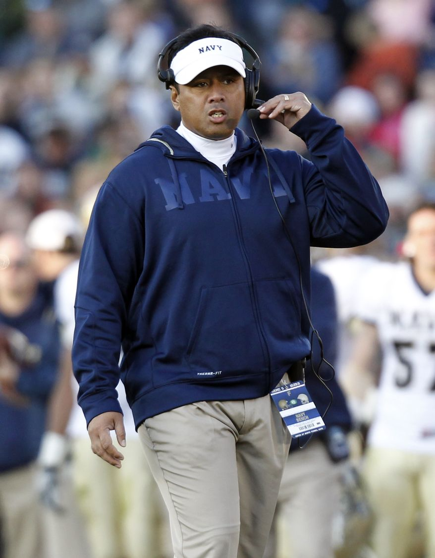 Navy coach Ken Niumatalolo paces the sidelines as his team plays Notre Dame in South Bend, Ind., Saturday, Oct. 29, 2011. Notre Dame defeated Navy 56-14. (AP Photo/Michael Conroy)
