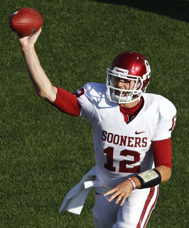 Oklahoma quarterback Landry Jones passed for 505 yards and five touchdowns to lead Oklahoma to a 58-17 win over Kansas State on Saturday. (AP Photo/Orlin Wagner)