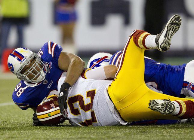 Buffalo Bills defensive end Dwan Edwards sacks Washington Redskins quarterback John Beck during the game in Toronto on Sunday, Oct. 30, 2011. (AP Photo/The Canadian Press, Frank Gunn)