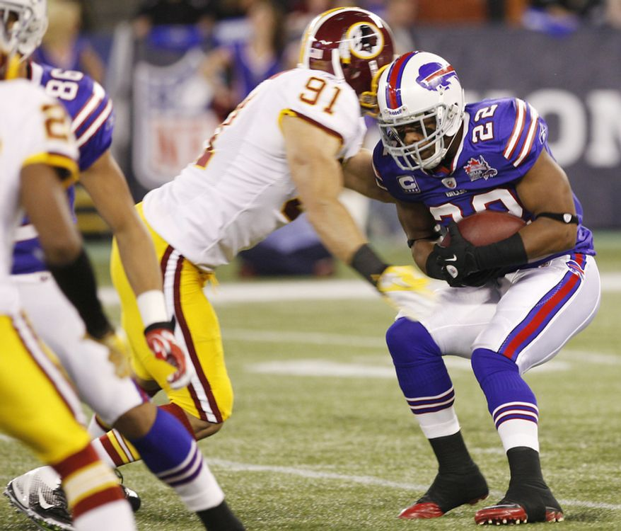 Buffalo Bills' Fred Jackson (22) is stopped behind the line of scrimmage by Washington Redskins' Ryan Kerrigan (91) during the first quarter of an NFL football game at the Rogers Centre in Toronto, Sunday, Oct. 30, 2011. (AP Photo/Derek Gee)