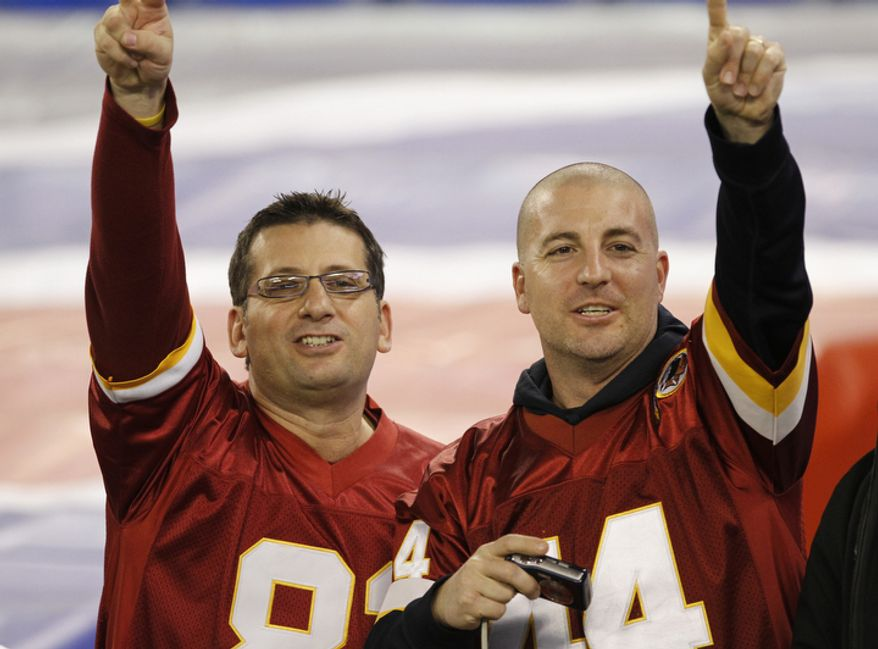 Washington Redskins fans cheer during warmups before an NFL football game against the Buffalo Bills at the Rogers Centre in Toronto, Sunday, Oct. 30, 2011. (AP Photo/Derek Gee)
