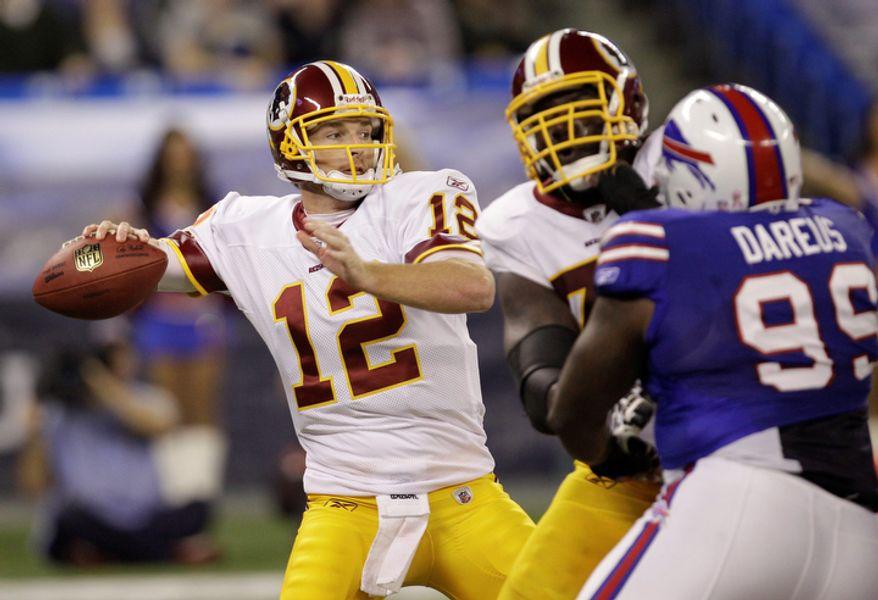 Washington Redskins quarterback John Beck throws (12) against the Buffalo Bills during the first quarter of an NFL football game in Toronto on Sunday, Oct. 30, 2011. (AP Photo/David Duprey)