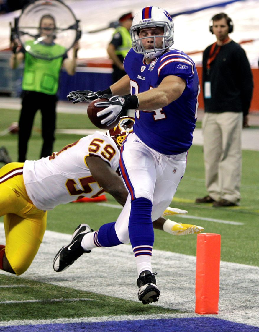 Buffalo Bills' Scott Chandler, right, scores a touchdown as Washington Redskins' London Fletcher (59) can't make the tackle during the first quarter of an NFL football game in Toronto on Sunday, Oct. 30, 2011. (AP Photo/David Duprey)
