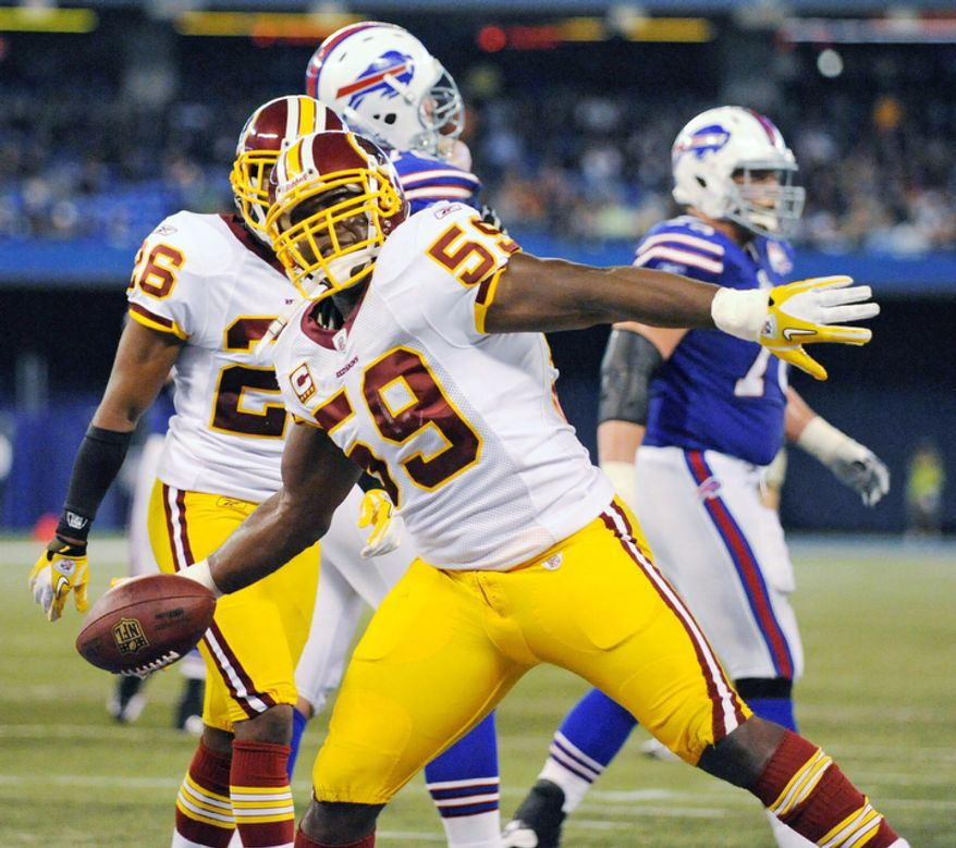 Washington Redskins' London Fletcher (59) celebrates his interception against the Buffalo Bills during the first half of an NFL football game at the Rogers Centre in Toronto, Sunday, Oct. 30, 2011. (AP Photo/Gary Wiepert)