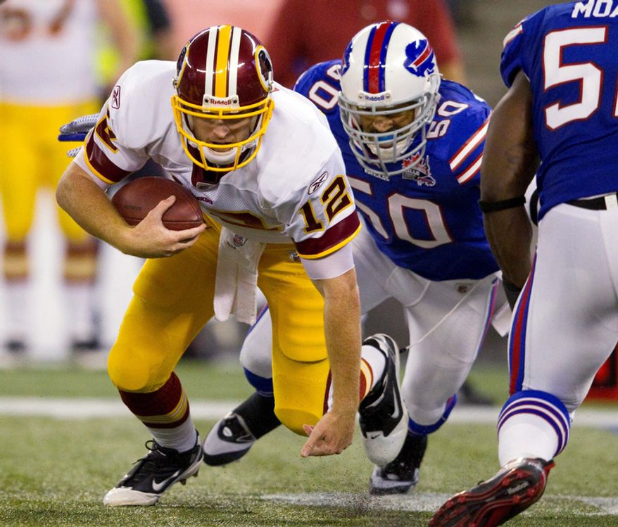 Buffalo Bills linebacker Nick Barnett (50) closes in to sack Washington Redskins quarterback John Beck (12) during the first half of an NFL football game in Toronto on Sunday, Oct. 30, 2011. (AP Photo/The Canadian Press, Frank Gunn)