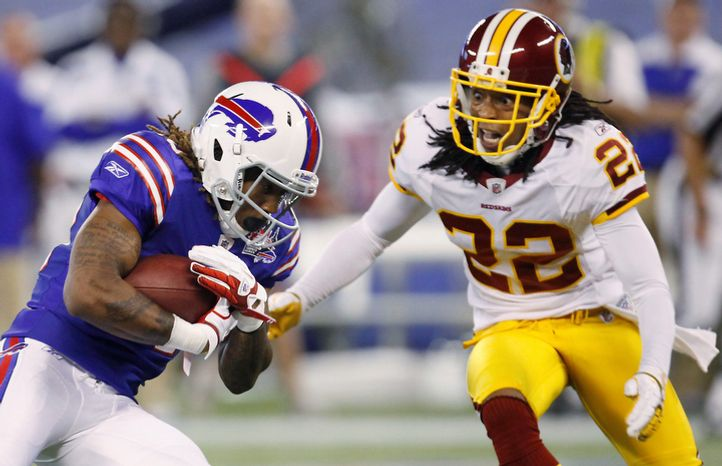 Buffalo Bills' Naaman Roosevelt carries the ball against Washington Redskins' Kevin Barnes (22) during the first half of an NFL football game in Toronto, Sunday, Oct. 30, 2011. (AP Photo/Derek Gee)
