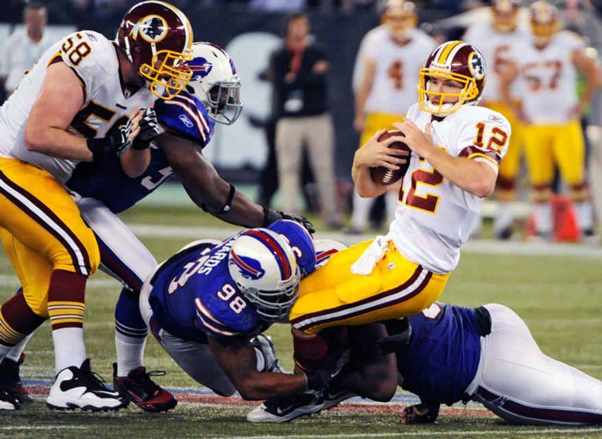Washington Redskins quarterback John Beck was sacked 10 times by the Buffalo Bills last Sunday. (AP Photo/Gary Wiepert)