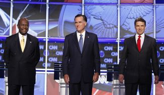 ** FILE ** Businessman Herman Cain (left), former Massachusetts Gov. Mitt Romney (center) and Texas Gov. Rick Perry are pictured before a Republican presidential debate on Tuesday, Oct. 18, 2011, in Las Vegas. (AP Photo/Isaac Brekken)