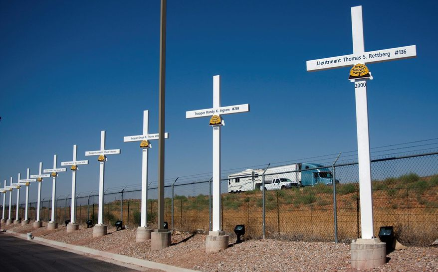 Steel crosses honoring Utah State Highway troopers killed in the line of duty line Interstate 15 in Hurricane, Utah. The Supreme Court on Monday declined to hear an appeal of a 10th Circuit Court ruling that the crosses on public property violate the Constitution. (Associated Press)