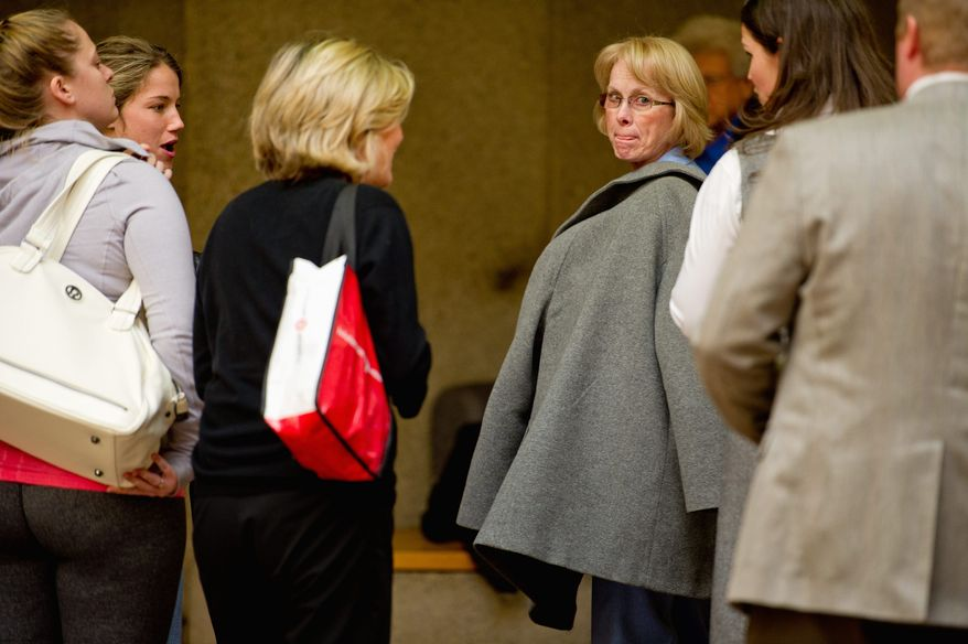 Phyllis Murray (center right), the mother of Jayna Murray, arrives at Montgomery County Circuit Court in Rockville on Monday for the murder trial of Brittany Norwood. Ms. Norwood is accused of slaying Mrs. Murray's daughter in March. (Andrew Harnik/The Washington Times)