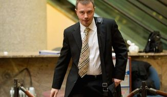 Montgomery County Police Detective Dimitry Ruvin leaves court in Rockville on Monday after testifying in the murder trial of Brittany Norwood. (Andrew Harnik/The Washington Times)
