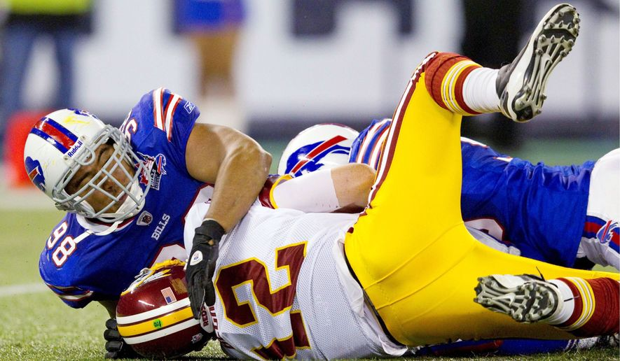 The Redskins had problems on both sides of the ball in Sunday's shutout loss. Quarterback John Beck was sacked a franchise-record nine times. (Associated Press)