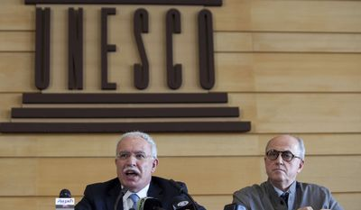 Palestinian Foreign Minister Riad al-Maliki (left) and Elias Sanbar, historian and ambassador for Palestine at UNESCO, face the media during a press conference at UNESCO's 36th General Conference in Paris on Oct. 31, 2011. (Associated Press)