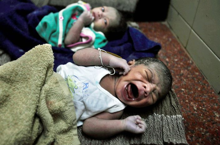 Newly born babies lie at a government hospital in Hyderabad, India, on Monday. Already the second most populous country with 1.2 billion people, India is expected to overtake China around 2030 when its population soars to an estimated 1.6 billion. (Associated Press)