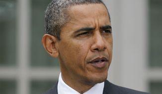 President Obama speaks in the Rose Garden of the White House in Washington on Thursday, Oct. 20, 2011. (AP Photo/Pablo Martinez Monsivais)