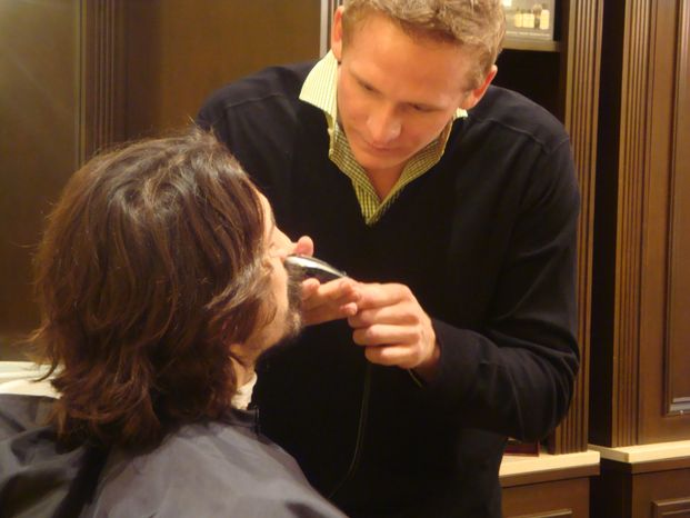 Corey Perry helps George Parros shave his facial hair for Movember. (Jess Milcetich)