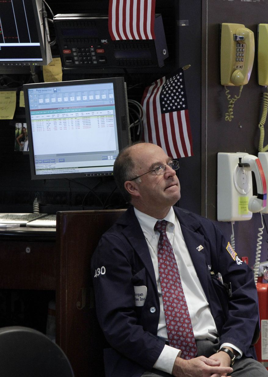 A trader watches the numbers as he works on the floor of the New York Stock Exchange on Oct. 31, 2011. (Associated Press)