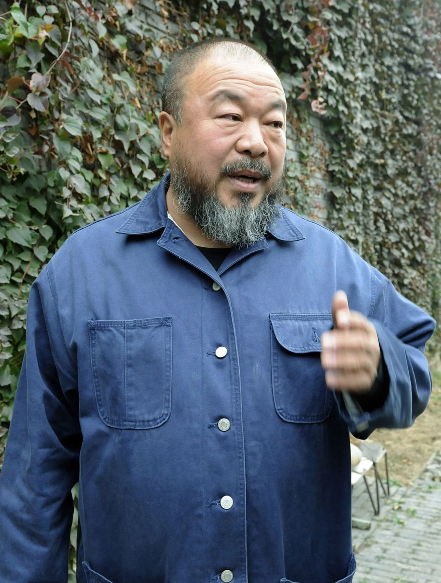 """""""We can pay this money, but we need to know why we have to,"""" Chinese artist Ai Weiwei says Tuesday of China's demand for $2.4 million in back taxes and fines from the dissident, who was detained for nearly three months earlier this year. """"We cannot just unwittingly hand over a sum of money."""" (Kyodo News via the Associated Press)"""