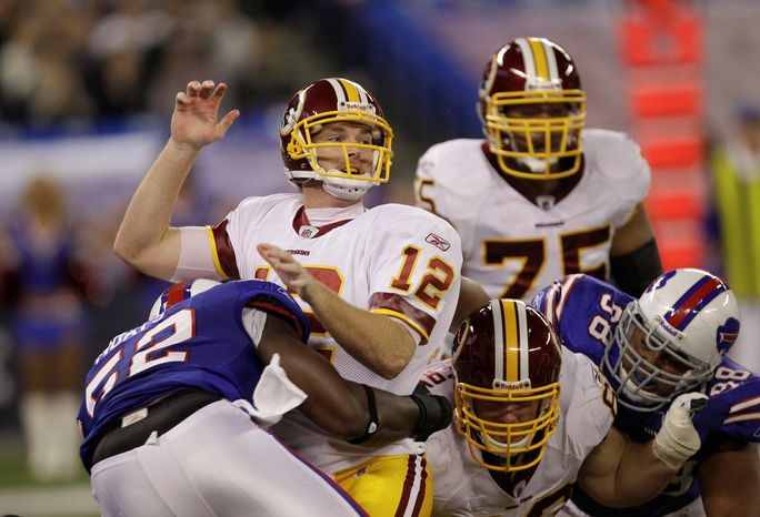 Because of a rash of injuries, Redskins offensive linemen Sean Locklear (upper right) and Will Montgomery (lower right) are playing positions that don't suit their strengths. That provides some explanation why quarterback John Beck (12) was sacked a franchise-record nine times during Sunday's 23-0 loss to the Buffalo Bills. (Associated Press)