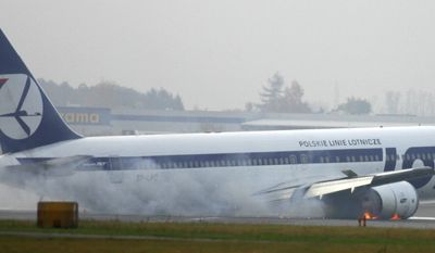 A Boeing 767 of LOT Polish Airlines makes an emergency landing at the Warsaw airport on Tuesday, Nov. 1, 2011, after experiencing landing-gear trouble. The plane was en route from Newark, N.J., with 231 people on board. (AP Photo)