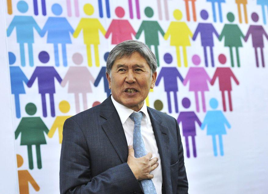 ** FILE ** President-elect Almazbek Atambayev speaks to the press in Bishkek, Kyrgyzstan, on Tuesday, Nov. 1, 2011. (AP Photo/Vladimir voronin)