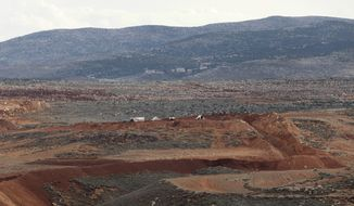 Syrian army positions are pictured on Monday, Oct. 31, 2011, near the border town of Serhaniyeh, Lebanon, whose residents say troops have laid mines nearby over the past several days. (AP Photo/Bilal Hussein)