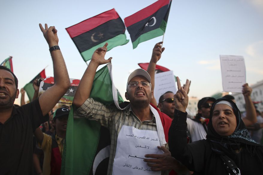 **FILE** People demonstrate in favor of the National Transitional Council in the main square of Tripoli, Libya, on Oct. 3, 2011. (Associated Press)