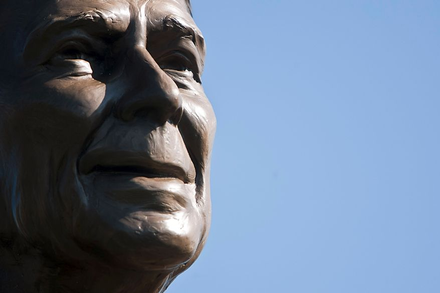 A bronze statue of Ronald Reagan is dedicated Nov. 1, 2011, at Reagan National Airport in Arlington, Va., on the centennial of the former president's birth. (T.J. Kirkpatrick/The Washington Times)
