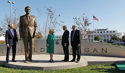 From left: Frederick Ryan Jr., chairman of the Board of Trustees of the Ronald Reagan Presidential Foundation; former Transportation Secretary Elizabeth Dole; Transportation Secretary Ray LaHood and Charles Snelling, chairman of the Board of the Metropolitan Washington Airports Authority, unveil the statue of President Reagan, on Nov. 1, 2011, at Washington's Ronald Reagan National Airport. (Associated Press)