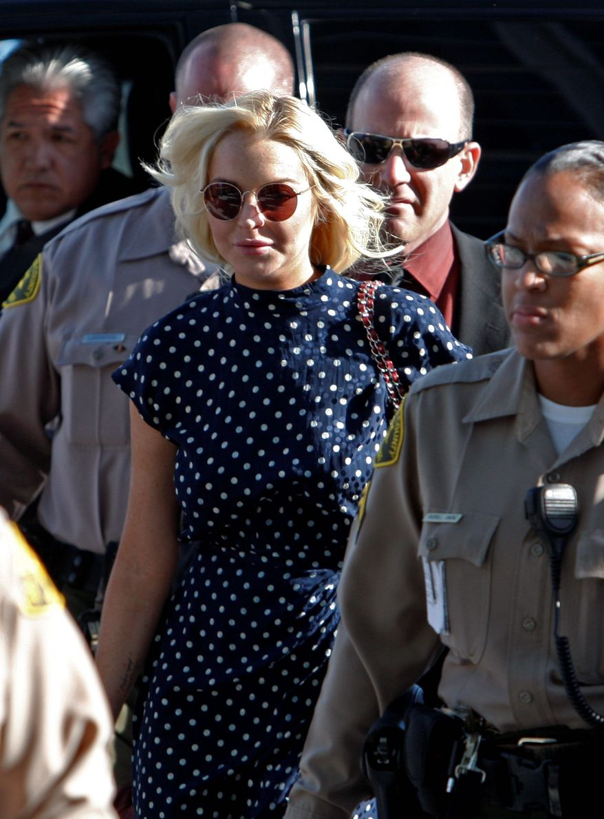 Actress Lindsay Lohan arrives at Los Angeles County Superior Court on Wednesday. Miss Lohan was sentenced to 30 days in jail for a probation violation after she was terminated from a community service assignment at a women's shelter. (Associated Press)