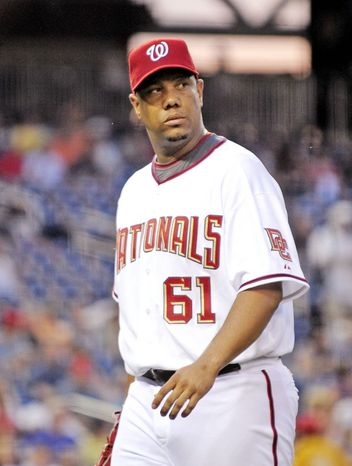Ex-Nationals pitcher Livan Hernandez has a history of legal wranglings with SunTrust Bank. (The Washington Times)