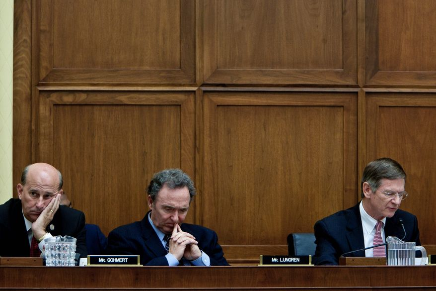 T.J. Kirkpatrick/The Washington Times From left, Reps. Louie Gohmert of Texas and Dan Lungren of California listen Wednesday as fellow Republican Rep. Lamar Smith of Texas speaks in support of issuing a subpoena to the Department of Homeland Security.