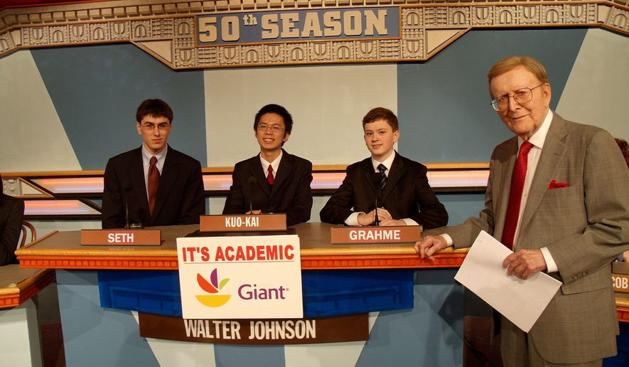 """It's Academic"" host Mac McGarry, seen on set in April with students from Bethesda's Walter Johnson High School, hosted the Washington-based quiz show for 50 years, asking more than 200,000 questions before his retirement was announced Wednesday. (NBC4)"