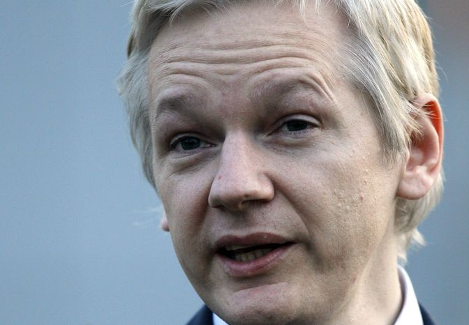 ** FILE ** This is a Monday, Feb. 7, 2011, file photo of WikiLeaks founder Julian Assange as he leaves Belmarsh Magistrates' Court in London. (AP Photo/Kirsty Wigglesworth, File)