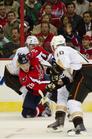 ** FILE ** Alexander Semin (28) of the Washington Capitals fights for the puck against the Anaheim Ducks in NHL Hockey at the Verizon Center, Washington, D.C., Tuesday, Nov. 1, 2011. (Andrew Harnik/The Washington Times)