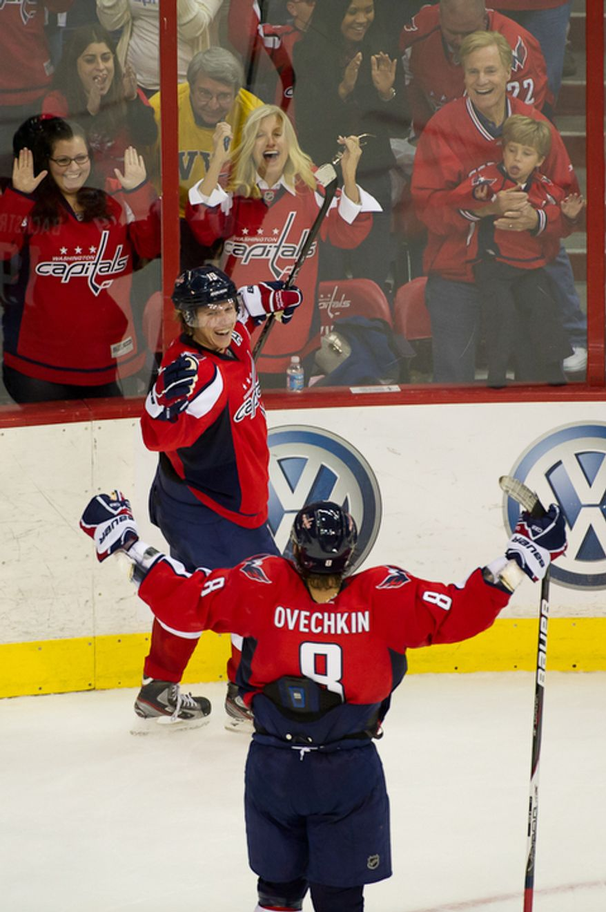 Nicklas Backstrom (19) of the Washington Capitals scores the winning goal in overtime against goalie Jonas Hiller (1) of the Anaheim Ducks in NHL Hockey at the Verizon Center, Washington, DC, Tuesday, November 1,  2011. (Andrew Harnik / The Washington Times)