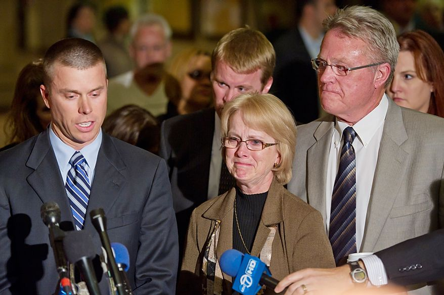 David Murray (right) and wife Phyllis, the parents of murder victim Jayna Murray, listen as their son Hugh (left), speaks to reporters at the Montgomery County Circuit Court in Rockville, Md., on Nov. 2, 2011, after Brittany Norwood, a co-worker of Jayna's, was found guilty of the killing. (Andrew Harnik/The Washington Times)