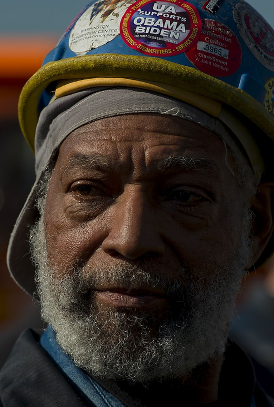 Laphonsor Price of Bowie, Md, and a member of Steamfitters Local 602, chats with reporters as he and others wait for President Barack Obama's arrival and remarks urging Congress to pass the infrastructure part of the American Jobs Act, in front of a crowd which included iron workers and steam fitters, at Georgetown Waterfront Park in Washington, D.C., Wednesday, November 2, 2011. (Photo/Rod Lamkey Jr./The Washington Times)
