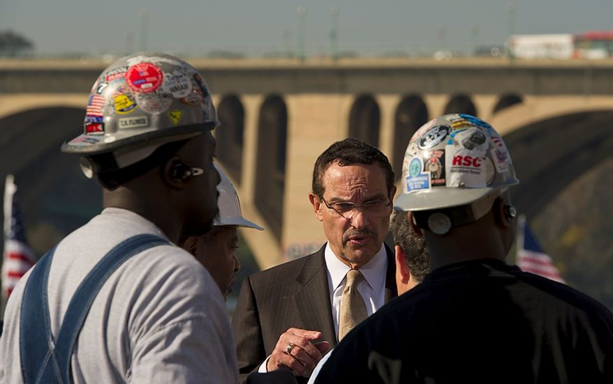 Washington D.C. Mayor Vincent Gray (center) chats with iron workers and others as they wait for President Barack Obama to arrive and offer remarks urging Congress to pass the infrastructure part of the American Jobs Act, in front of a crowd which included iron workers and steam fitters, at Georgetown Waterfront Park in Washington, D.C., Wednesday, November 2, 2011. (Photo/Rod Lamkey Jr./The Washington Times)