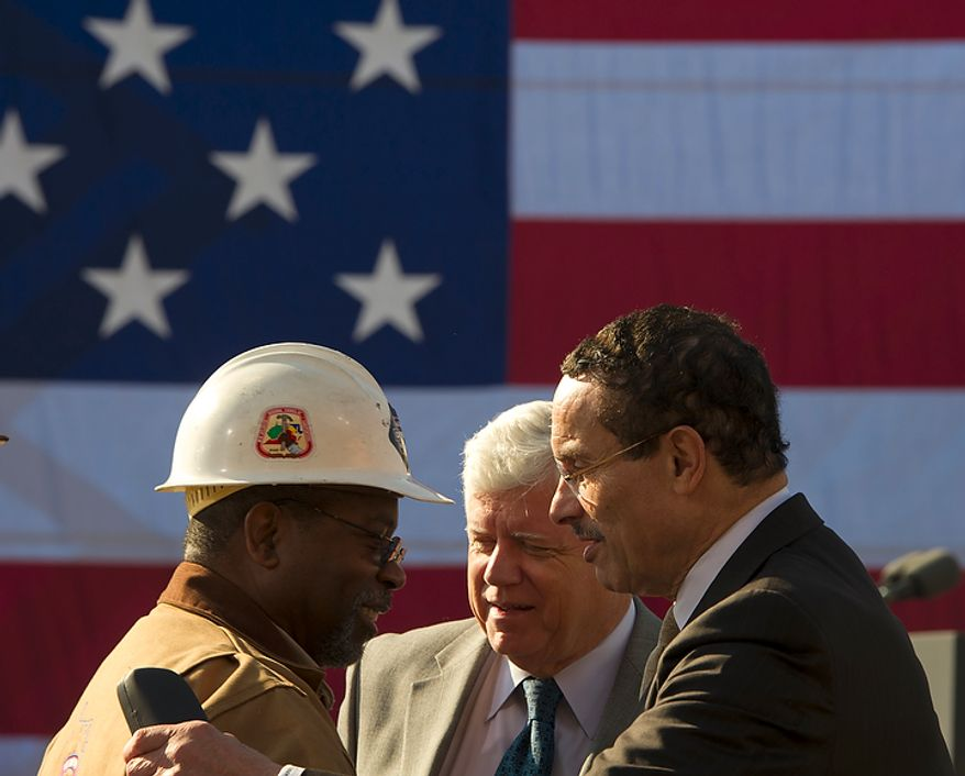Washington D.C. Mayor Vincent Gray (right) chats with Mid-Atlantic Regional Council of Carpenters Deputy Public Affairs Director Thomas Blanton (left) and Rep. John Larson (D-CT, center) as they wait for President Barack Obama to arrive and offer remarks urging Congress to pass the infrastructure part of the American Jobs Act, in front of a crowd which included iron workers and steam fitters, at Georgetown Waterfront Park in Washington, D.C., Wednesday, November 2, 2011. (Photo/Rod Lamkey Jr./The Washington Times)