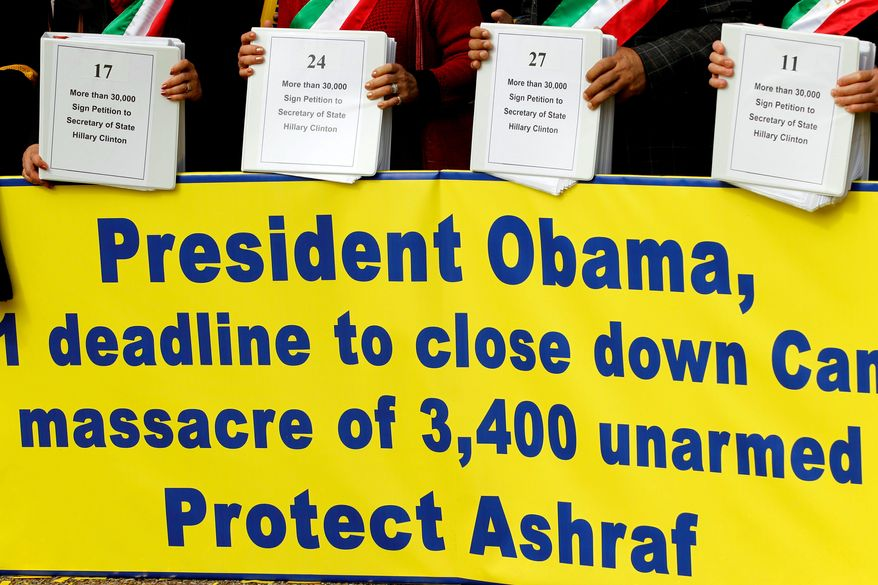 Demonstrators hold petitions asking President Obama to protect Iranians at Camp Ashraf in Iraq during a rally at the White House on Saturday.