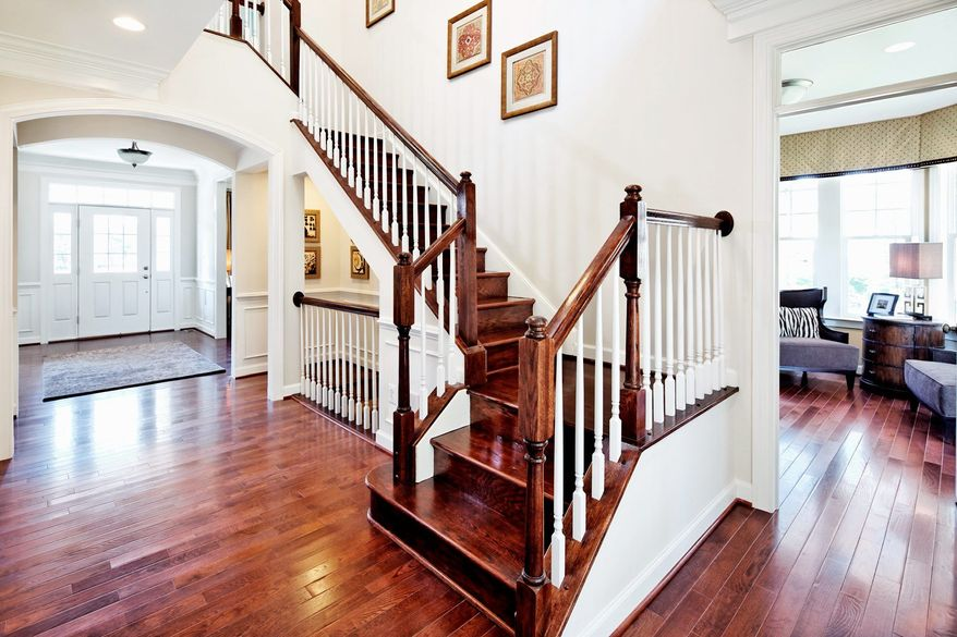 The foyer in the Canterbury model has access to the living room and the rear study. The foyer has hardwood flooring.
