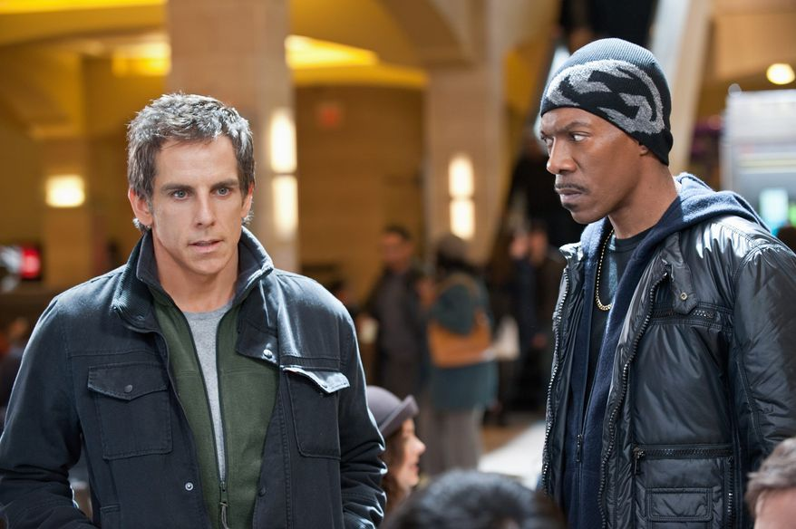 "Ben Stiller (left) and Eddie Murphy play somewhat goofy Robin Hood-style thieves in the caper comedy ""Tower Heist"" set at an elite high-rise in Manhattan. (Universal Pictures via Associated Press)"