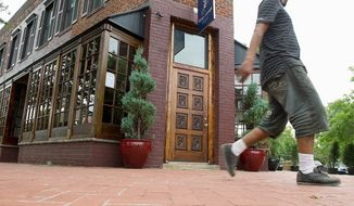 A man walks past Shaw's Tavern on Florida Ave. NW in Washington, D.C., Monday, Aug. 29, 2011. The tavern, which opened July 29, does not have a liquor license, so it has shut down until they are able to procure one. (Barbara L. Salisbury/The Washington Times)