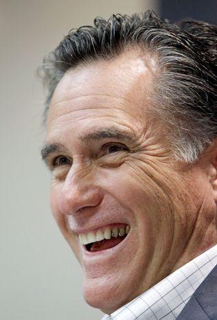Former Massachusetts Gov. Mitt Romney speaks during an economic roundtable at the Treynor State Bank in Treynor, Iowa, on Thursday. (Associated Press)