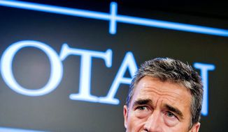 Secretary-General Anders Fogh Rasmussen speaks during the monthly NATO media briefing in Brussels on Thursday. (Associated Press)
